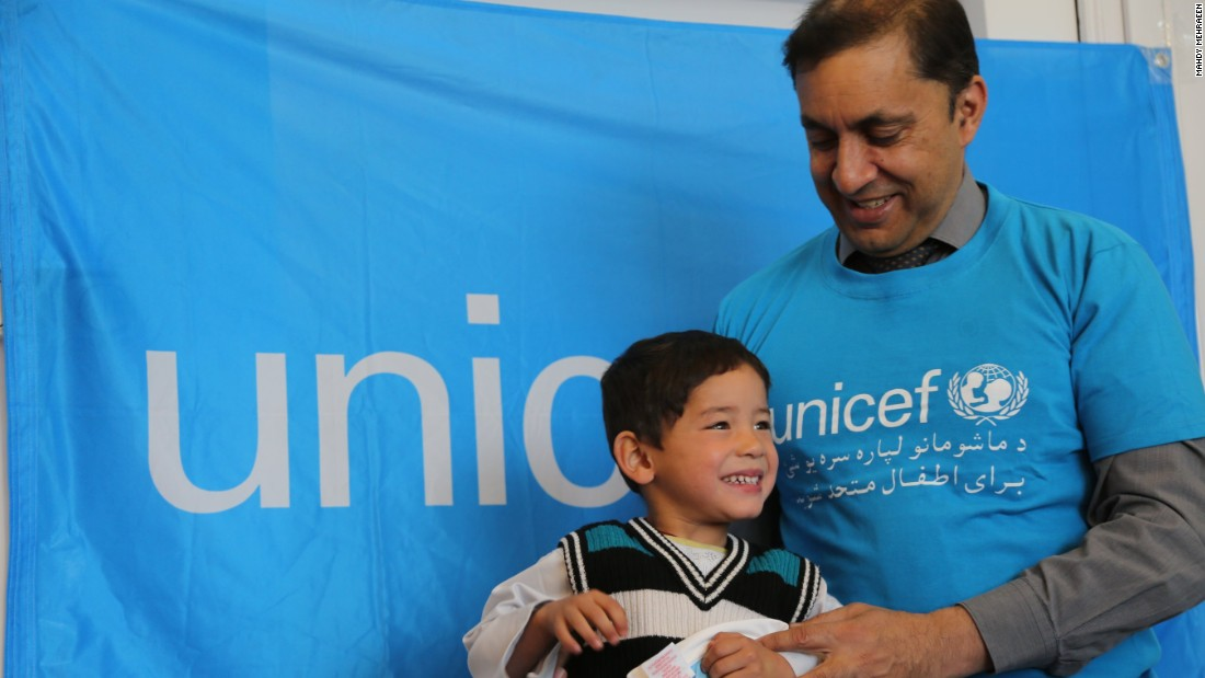 UNICEF Afghanistan representative Akhil Iyer presents the thrilled Murtaza with his gifts from Messi, the Argentine star who plays for Barcelona.