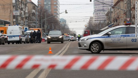 Police and the Investigative Committee  cars secure an area abound a subway station in Moscow on Monday, Feb. 29, 2016. Russian news agencies report that police have arrested a woman who was waving the severed head of a small child outside a Moscow subway station. The Investigative Committee released a statement saying a woman was arrested Monday on suspicion of killing a child aged 3 or 4 in an apartment near the metro station in northwestern Moscow and then setting the apartment on fire. The statement said the woman was believed to be the nanny. (AP Photo/Alexander Zemlianichenko)