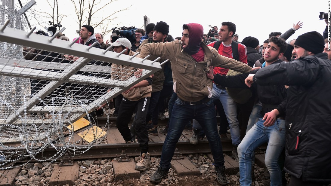 Clashes in migrant camps in France and Greece as tensions boil over