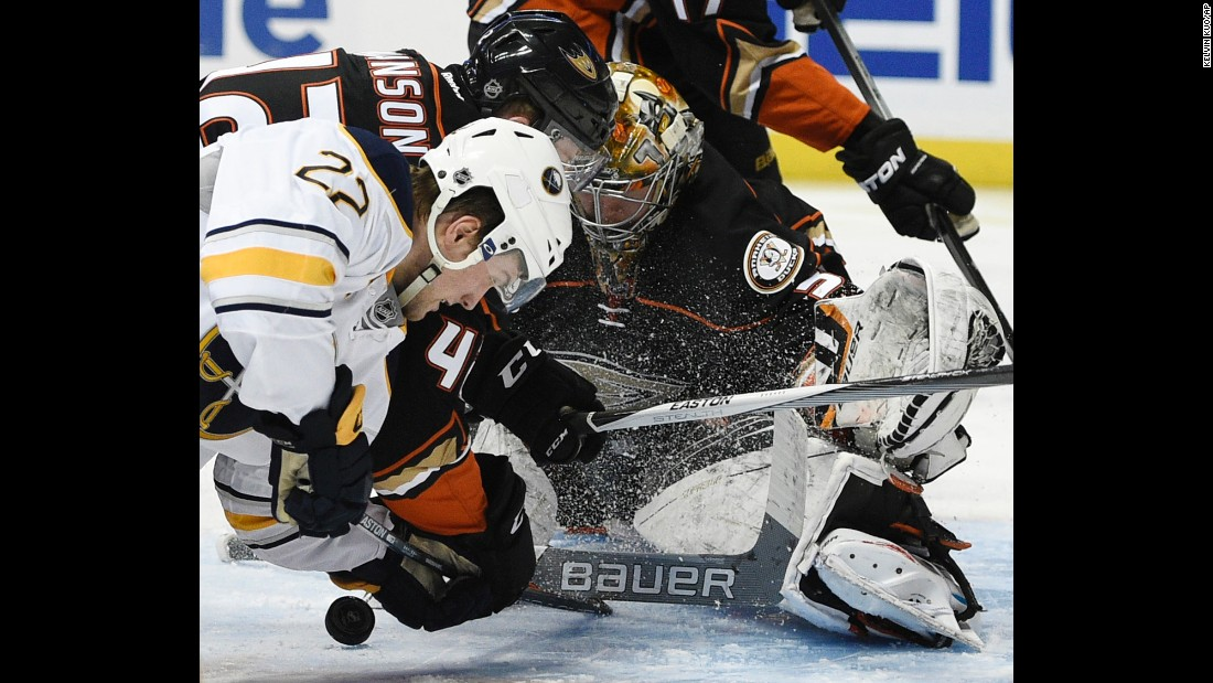 Anaheim goalie Frederik Andersen makes a save Wednesday, February 24, as teammate Josh Manson battles Buffalo's Johan Larsson in the crease.
