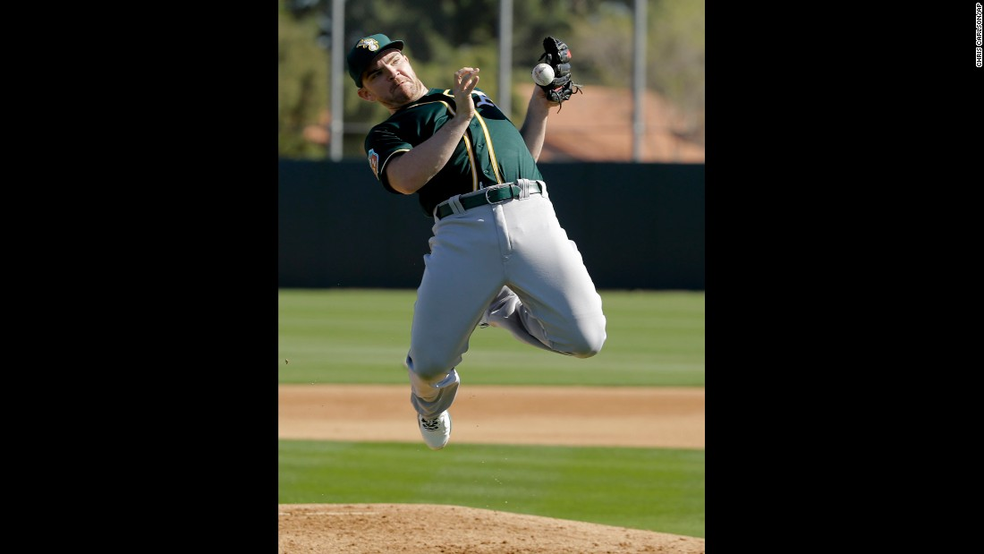 Oakland pitcher Liam Hendriks catches a ball during spring training drills in Mesa, Arizona, on Thursday, February 25.