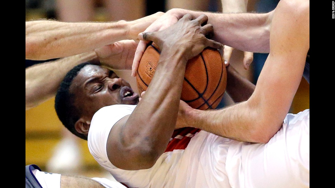 Rutgers' Ibrahima Diallo battles Northwestern players for a loose ball on Saturday, February 27.
