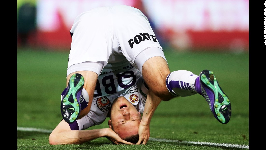 Chris Harold, a soccer player with the Perth Glory, falls over as he reacts to a missed opportunity Friday, February 26, in Sydney.