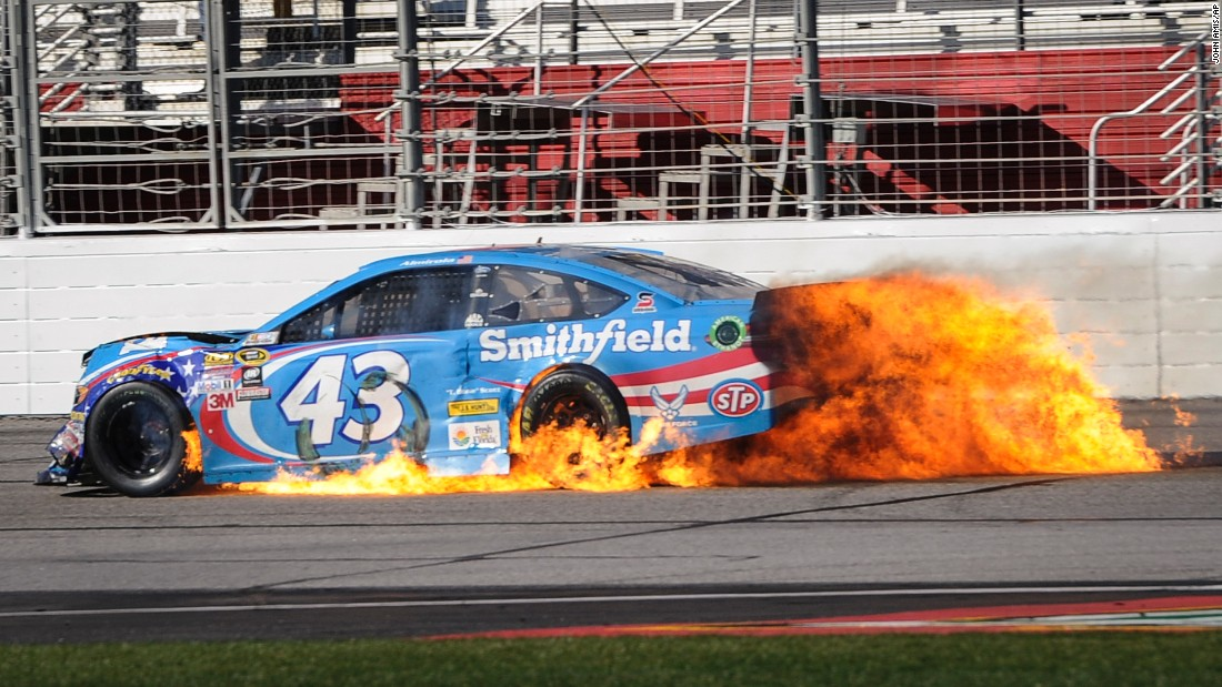 Aric Almirola's Sprint Cup car catches fire after a last-lap crash at Atlanta Motor Speedway on Sunday, February 28. He was OK.
