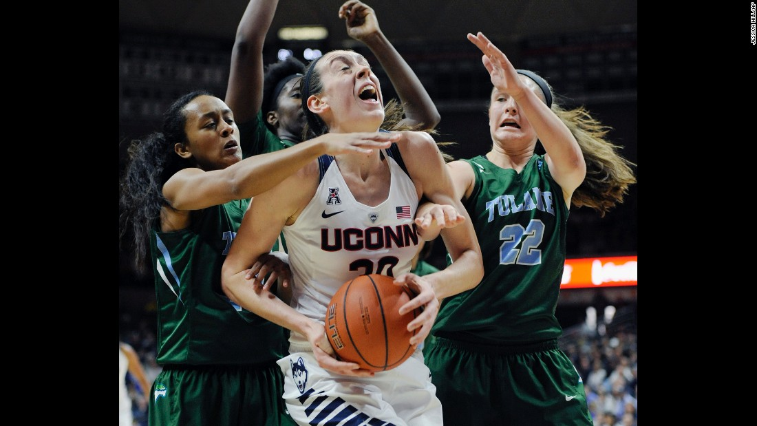 UConn's Breanna Stewart is swarmed by Tulane defenders during a game in Storrs, Connecticut, on Saturday, February 27. Stewart and the Huskies are undefeated this season as they seek their fourth straight national title.
