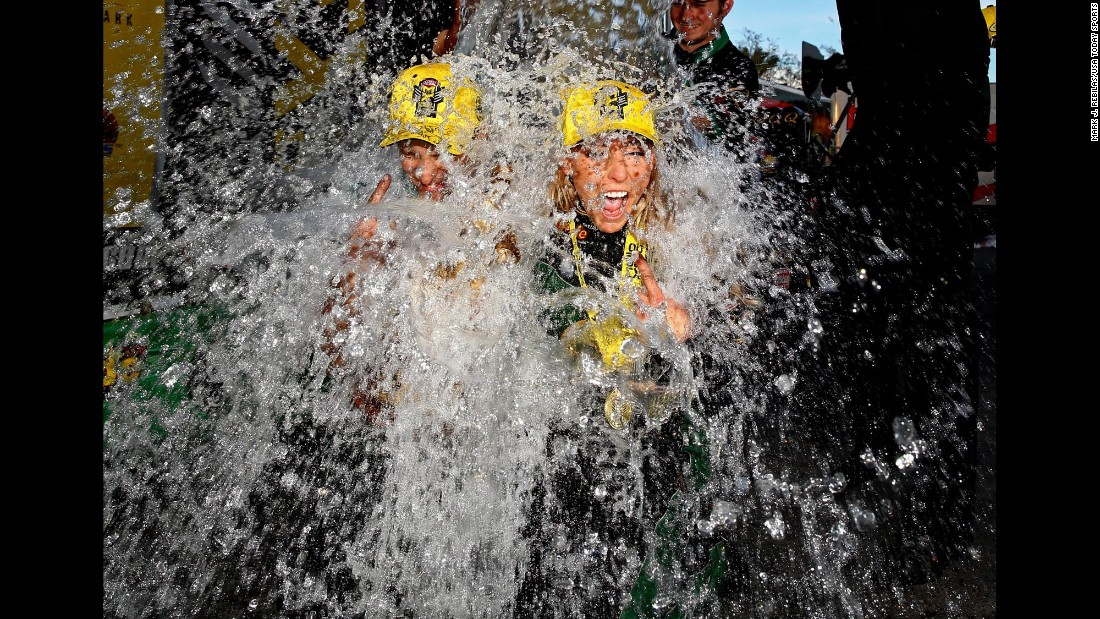 Drag racer Leah Pritchett is doused with a cooler full of ice water after she won the Carquest Nationals in Chandler, Arizona, on Sunday, February 28.