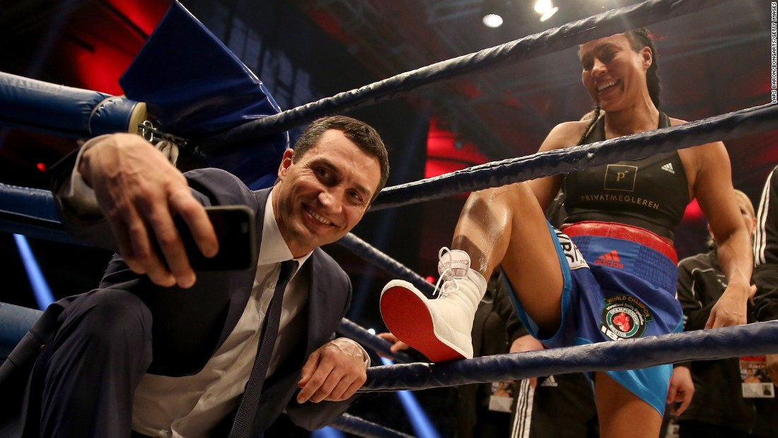 Former boxing champion Wladimir Klitschko takes a selfie with Cecilia Braekhus after she defended her welterweight titles in Halle, Germany, on Saturday, February 27.