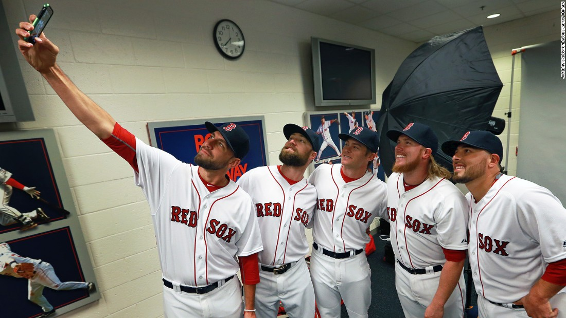 Boston Red Sox pitcher Matt Barnes takes a selfie with teammates -- from left, Bryce Brentz, Josh Rutledge, Robbie Ross Jr. and Ali Solis -- during spring training photo day on Sunday, February 28.