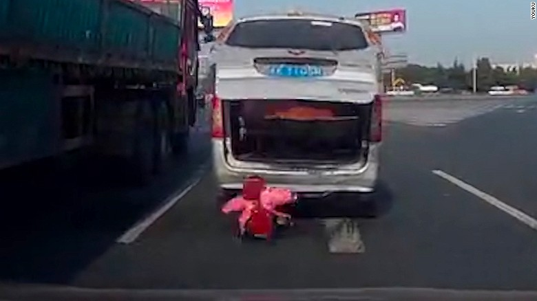 Toddler falls out of van on busy highway