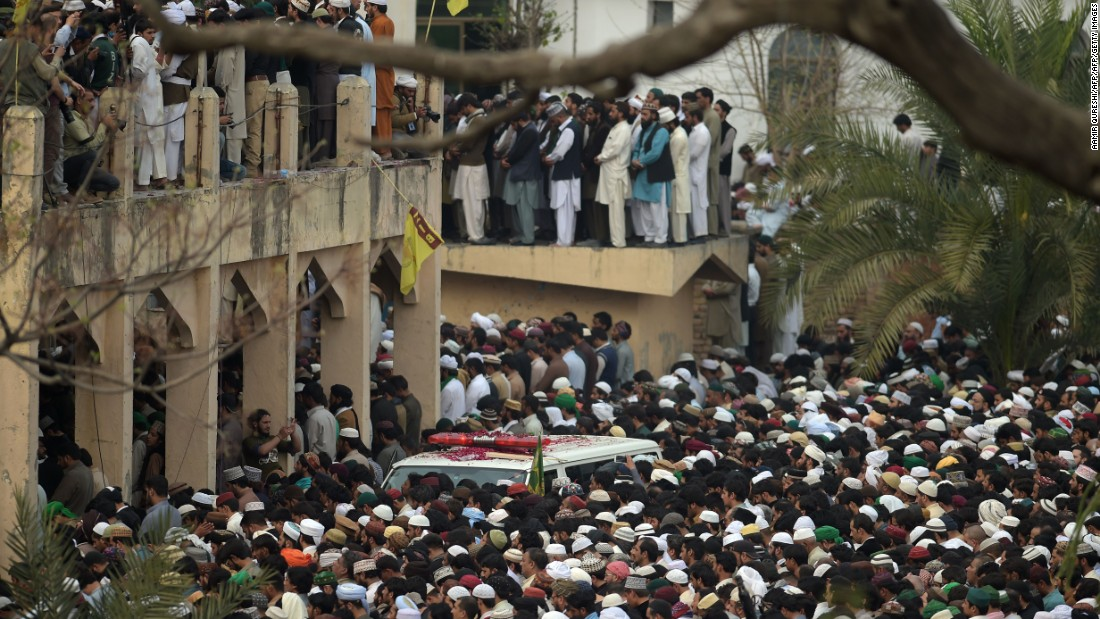 Supporters of the executed man offer funeral prayers for Qadri near the ambulance carrying his body a day after his execution.