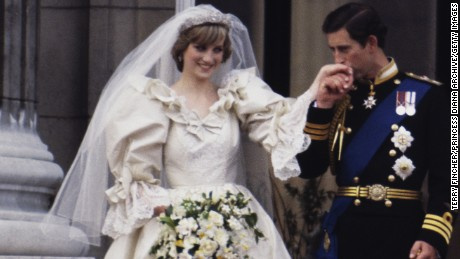 The Prince and Princess of Wales on the balcony of Buckingham Palace on their wedding day, 29th July 1981. She wears a wedding dress by David and Elizabeth Emmanuel and the Spencer family tiara. (Photo by Terry Fincher/Princess Diana Archive/Getty Images) Diana Spencer, 20 - Prince Charles, 33