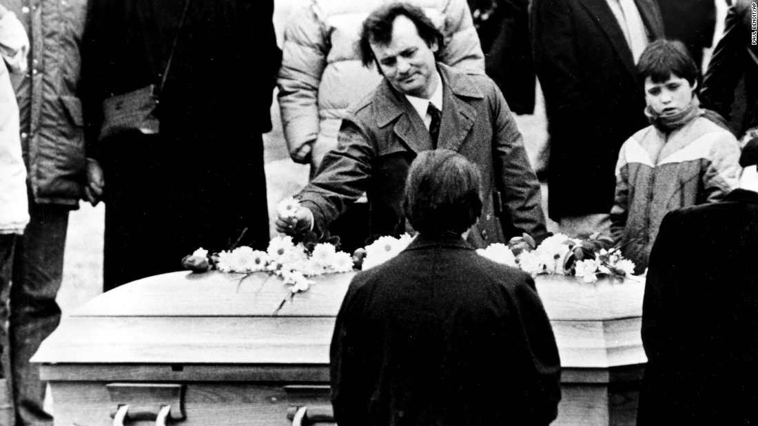 "<strong>Farewell to a funnyman:</strong> Actor Bill Murray puts a flower on John Belushi's coffin on March 9, 1982. Belushi, a beloved comedian and former ""Saturday Night Live"" star, <a href=""http://www.nytimes.com/1982/03/06/obituaries/john-belushi-manic-comic-of-tv-and-films-dies.html"" target=""_blank"">died of a drug overdose</a> at the age of 33."