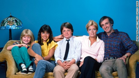 FAMILY TIES -- Season 1 -- Pictured: (l-r) Tina Yothers as Jennifer Keaton, Justine Bateman as Mallory Keaton, Michael J. Fox as Alex P. Keaton, Meredith Baxter as Elyse Keaton, Michael J. Fox as Alex P. Keaton -- Photo by: Herb Ball/NBC/NBCU Photo Bank