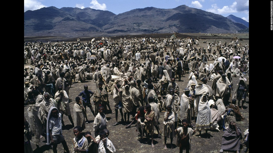"<strong>Picture of hunger:</strong> A period of drought <a href=""http://webra.cas.sc.edu/hvri/feature/oct2013_dom.aspx"" target=""_blank"">beginning in 1981</a> wiped out harvests and led to famine conditions in Ethiopia starting in 1983. Here, refugees in the Wollo district wait at a government site to receive food. By March 1984, the Ethiopian government estimated that 5 million people were at risk of starvation."