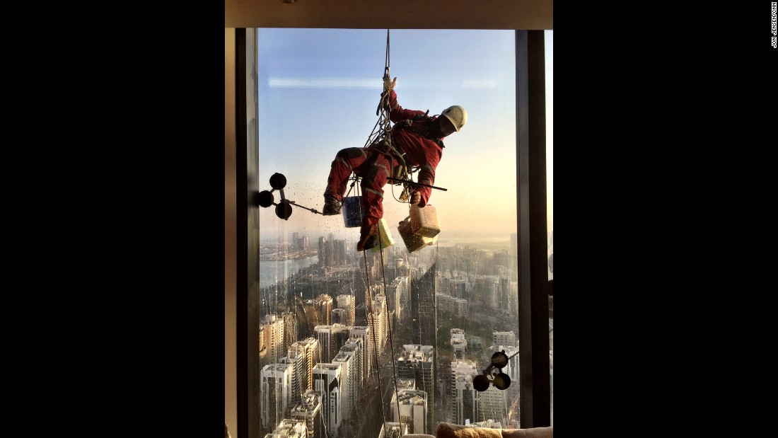 "UNITED ARAB EMIRATES: ""This is not an easy gig. Washing windows by hand in Abu Dhabi. All 90 floors."" - CNN's Jon Jensen <a href=""http://instagram.com/jonjensencnn"" target=""_blank"">@jonjensencnn</a>."