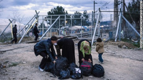 Migrants and refugees prepare their luggages after crossing the Greek-Macedonian border near the town of Gevgelija on March 3, 2016. - On March 3, EU President Donald Tusk issued a blunt warning to economic migrants not to come to Europe, and chastised EU countries which have taken unilateral action to tackle the crisis. Athens said it now had nearly 32,000 migrants on its territory, after Austria and Balkan states began restricting entries, creating a bottleneck in Greece.   / AFP / DIMITAR DILKOFFDIMITAR DILKOFF/AFP/Getty Images
