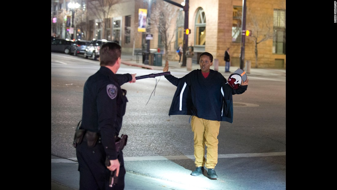 "Police stop a boy as he walks away from a crowd that formed after <a href=""http://www.cnn.com/2016/02/29/us/salt-lake-city-police-shooting/index.html"" target=""_blank"">an officer-involved shooting</a> in Salt Lake City on Saturday, February 27. The ordeal started when officers saw two males with metal objects attacking another male outside a homeless shelter, police said. Officers told the attackers to drop their weapons. One of them did, police said. The other, a 17-year-old boy, ""continued to advance on the victim and was shot by officers."" That's when the turmoil ensued. A crowd gathered and hurled bottles and rocks at officers, police said. Four people were arrested for crimes related to civil disorder. Both officers involved in the shooting have been placed on administrative leave pending the results of an investigation."