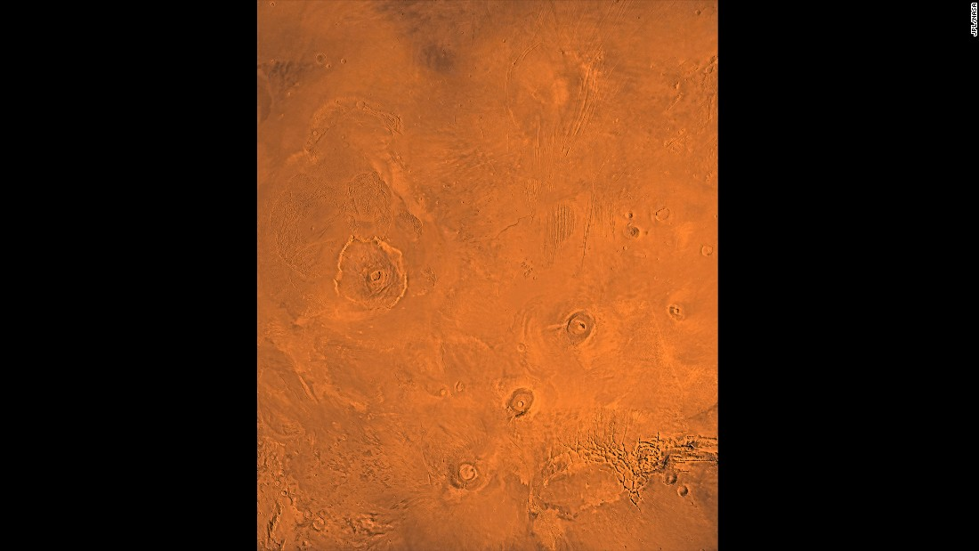 This image shows the Tharsis Bulge, a huge ridge on Mars covered by three large volcanoes (from lower left to right): Arsia, Pavonis and Ascraeus Mons. To the left is the huge Olympus Mons volcano.