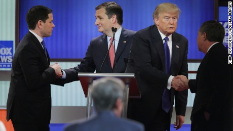 Republican presidential candidates (Lto R) Sen. Marco Rubio (R-FL), Sen. Ted Cruz (R-TX),  Donald Trump and Ohio Gov. John Kasich greet each following a debate sponsored by Fox News at the Fox theatre on March 3, 2016 in Detroit, Michigan.