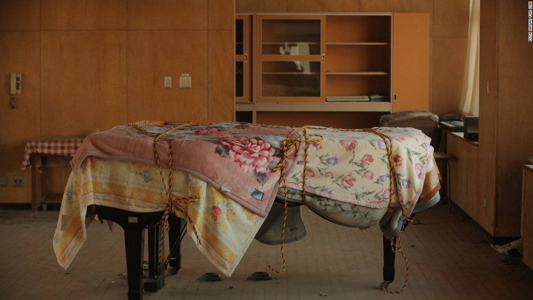 A dusty piano sits in an abandoned school near the Fukushima Daiichi nuclear plant.