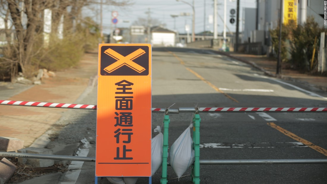 A road block marks the entrance to the Fukushima exclusion zone.