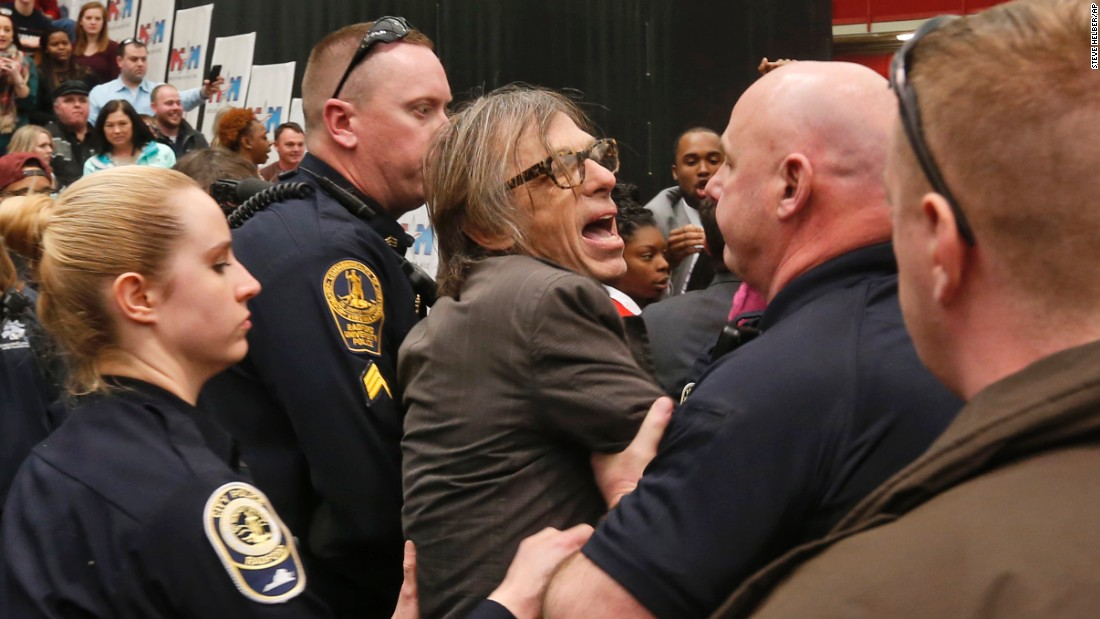 "Christopher Morris, a photographer on assignment for Time magazine, is escorted by police during a Donald Trump rally in Radford, Virginia, on Monday, February 29. Morris said a Secret Service agent <a href=""http://www.cnn.com/2016/02/29/politics/donald-trump-event-protest-rally/"" target=""_blank"">choked him and slammed him to the ground</a> as he tried to leave a media pen at the event. The incident was caught on video."