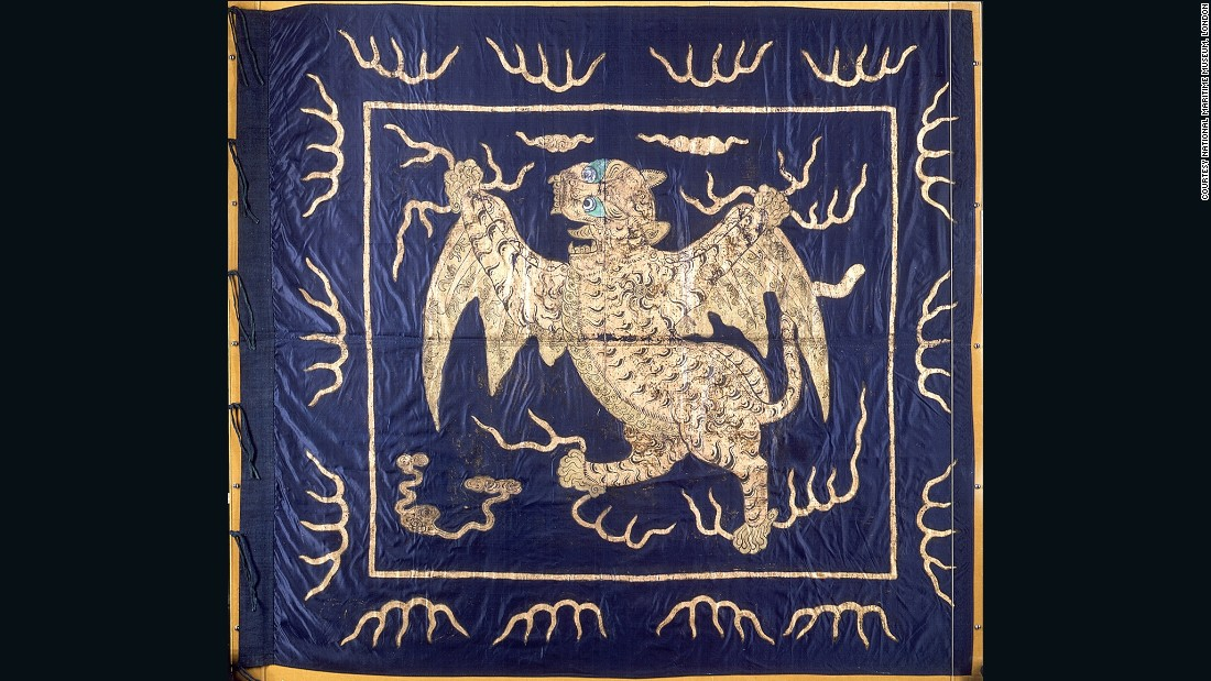 "This ornate Imperial Chinese flag is made from silk and features a winged tiger crafted in gold foil. The mythical creature with wild green eyes holds flashes of lightning in its claws.<br />""In terms of aesthetics, this is probably my favorite flag in the collection,"" Davey says of the intricate textile, which is one of the few <a href=""http://collections.rmg.co.uk/collections/objects/559.html"" target=""_blank"">now on display to the public.</a> ""It was taken during the capture of Canton in 1857.""  <br />"
