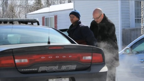 Philip Scott Fournier, 55, is taken into custody Friday, March 4, in connection with the 1980 slaying of 16-year-old Joyce McLain. Fournier was 19 at the time of the killing.