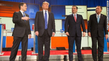 US Republican Presidential candidates (L-R) Marco Rubio, Donald Trump, Ted Cruz and John Kasich pose for a photo at start of the Republican Presidential Debate in Detroit on March 3, 2016.