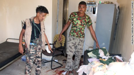 Yemeni pro-government fighters, loyal to exiled Yemeni President Abedrabbo Mansour Hadi, inspect an elderly care home in Yemen's main southern city of Aden after it was attacked by gunmen on March 4, 2016. Four gunmen stormed the facility housing dozens in Aden's Sheikh Othman district, killing a guard before tying up and shooting employees, the officials told AFP.