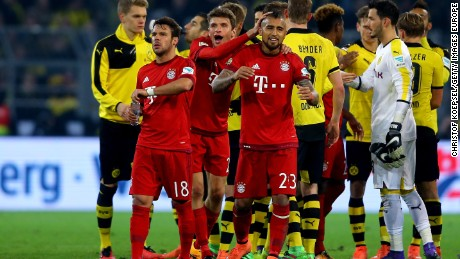 Juan Bernat, Thomas Mueller and Arturo Vidal of Bayern congratutalte each other after the Bundesliga match between Borussia Dortmund and FC Bayern Munich.