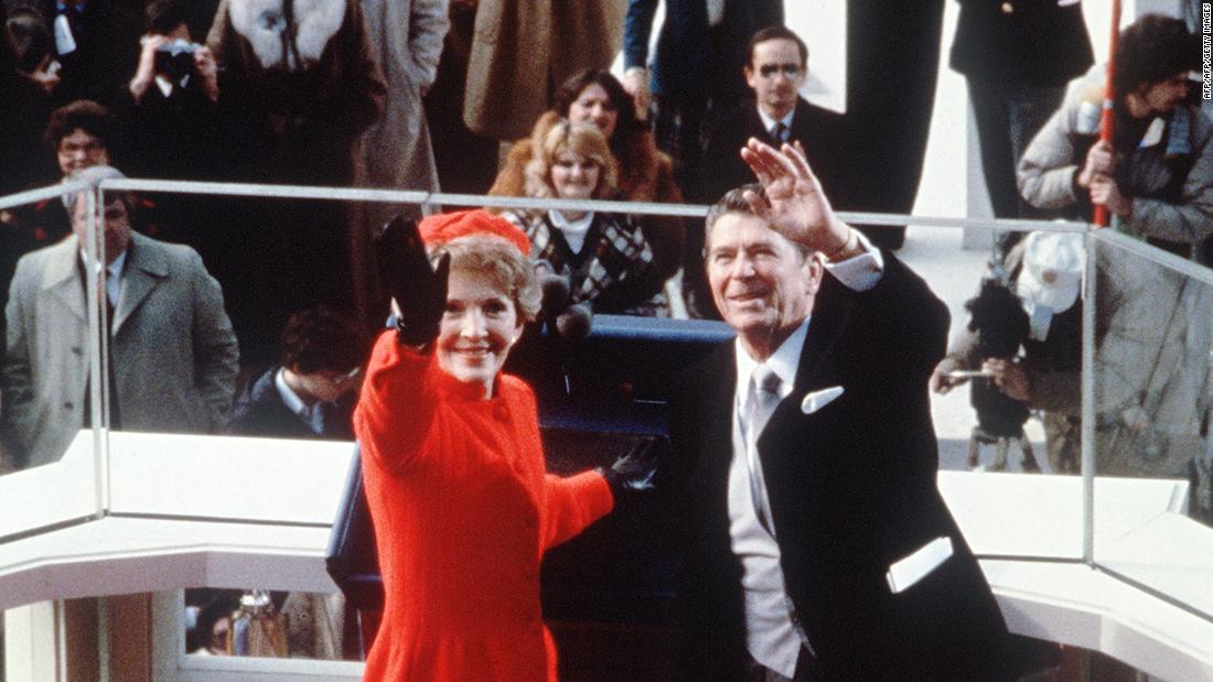 The Reagans wave after President Reagan was sworn in as 40th president of the United States by Chief Justice Warren Burger on January 20, 1981, at the Capitol in Washington. At right is Vice President George H.W. Bush.