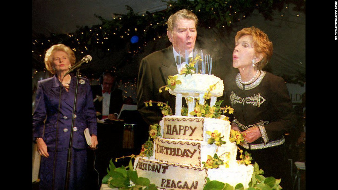 Ronald Reagan blows out the candles on his cake with help from Nancy as he celebrates his 82nd birthday on February 6, 1993. At left is former British Prime Minister Margaret Thatcher.