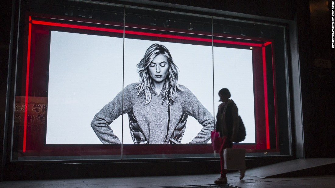 A shopper in Shanghai, China, walks past a Nike advertisement featuring Sharapova.