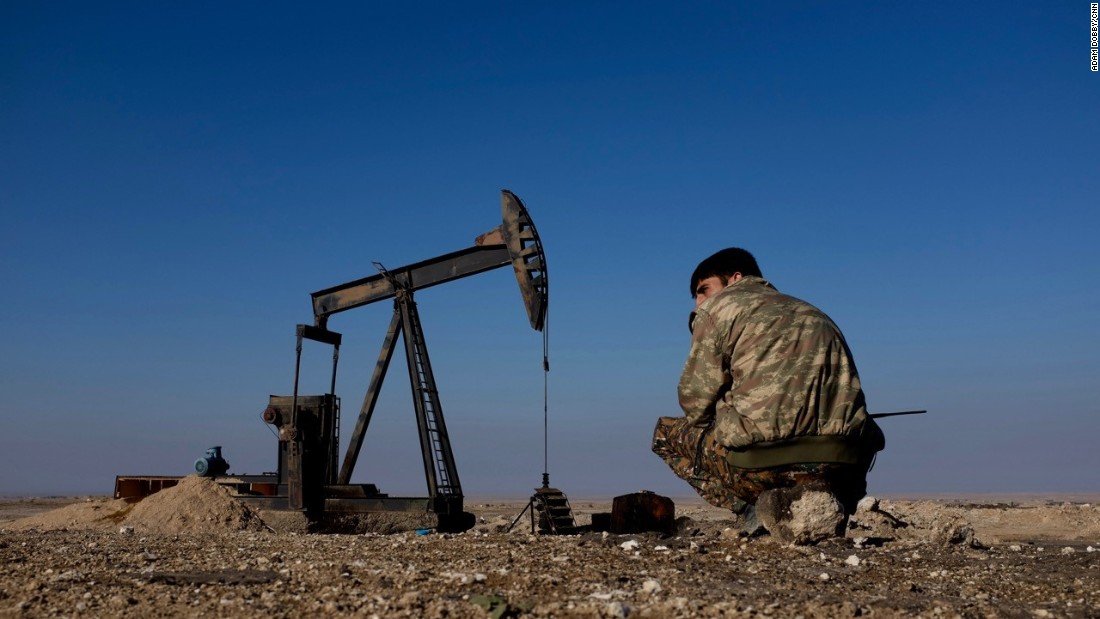 A Kurdish YPG fighter on guard at an oil pump close to al Hawl, which lies in north-eastern Syria between the Turkish and Iraqi borders. ISIS carries out frequent suicide attacks in the area.