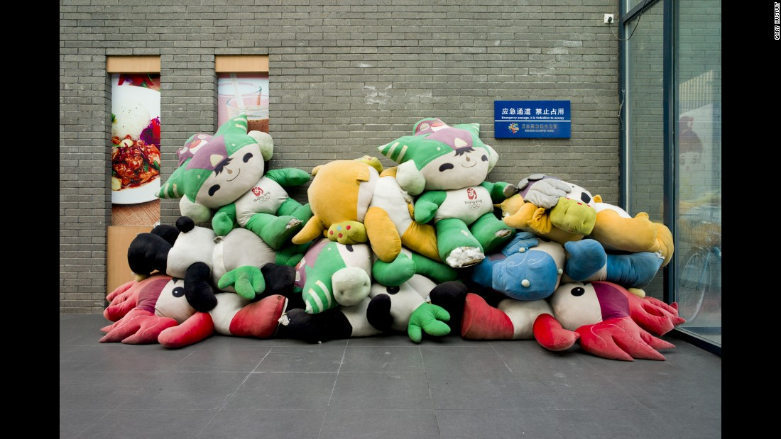 Mascots are piled up at the Olympic Green Park in Beijing. Photographers Jon Pack and Gary Hustwit visited 13 Olympic cities to document the legacy of the Games.