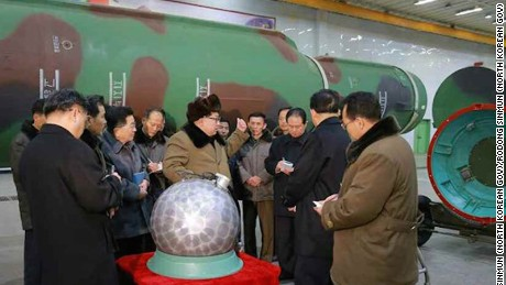 North Korean state media released photographs that it claims shows Kim Jong Un inspecting a miniaturized warhead. CNN cannot independently confirm the images.