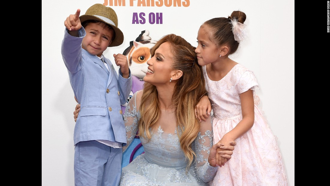 "Jennifer Lopez, son Max and daughter Emme attend the premiere of ""Home"" last year. The singer is proud her twins are bilingual thanks to her nanny who speaks to them in Spanish."
