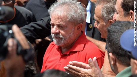 "Former Brazilian President Luiz Inacio Lula da Silva meets supporters gathering outside his house to show him their support, in Sao Bernardo do Campo, near Sao Paulo, Brazil, on March 5, 2016. Brazil's ex-president Lula da Silva vowed to battle his opponents in the streets in a defiant speech late Friday, hours after being briefly detained as part of a probe into a massive corruption scheme. Prosecutors said Lula was targeted as part of the Operation Car Wash investigation into a sprawling embezzlement and bribery conspiracy centred on the state oil giant Petrobras. Lula was not arrested, but held for questioning over alleged ""favors"" received from corrupt construction companies implicated in a kickback scheme, prosecutors said.   AFP PHOTO / NELSON ALMEIDA / AFP / NELSON ALMEIDA        (Photo credit should read NELSON ALMEIDA/AFP/Getty Images)"