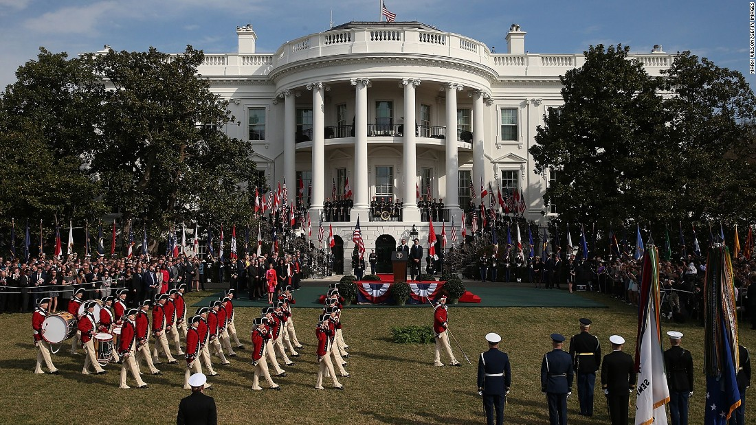A fife and drum corps performs during the arrival ceremony on the South Lawn.
