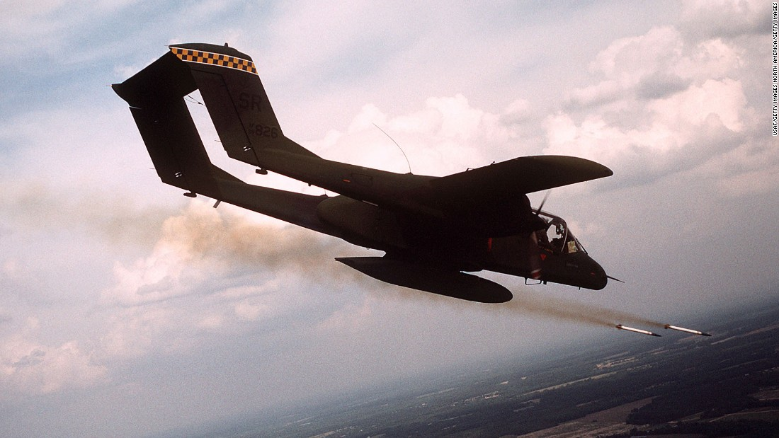 A 21st Tactical Air Support Squadron OV-10 Bronco aircraft fires white phosphorus rockets to mark a target for an air strike during tactical air control training.