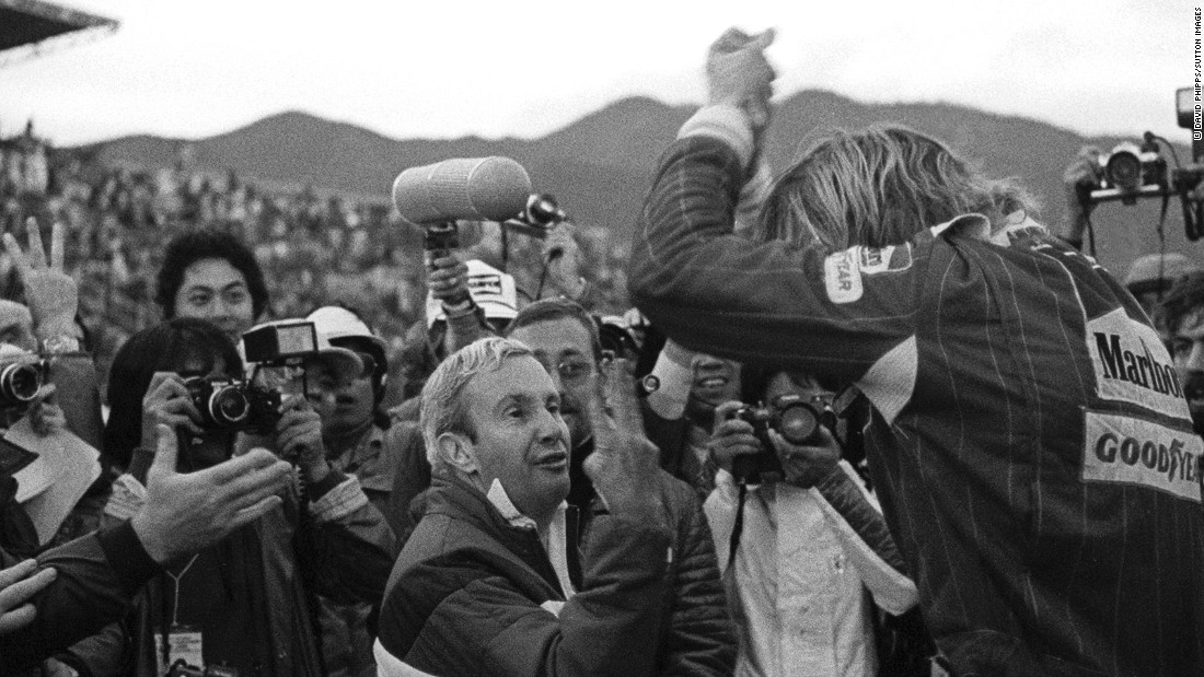 Hunt clinched his one and only F1 drivers' championship in the final race of the season -- the Japanese Grand Prix in Fuji. Here, McLaren team manager Teddy Mayer holds up three fingers to Hunt (right), who is climbing out of his car after the race, to signal he had finished third and clinched the 1976 title.