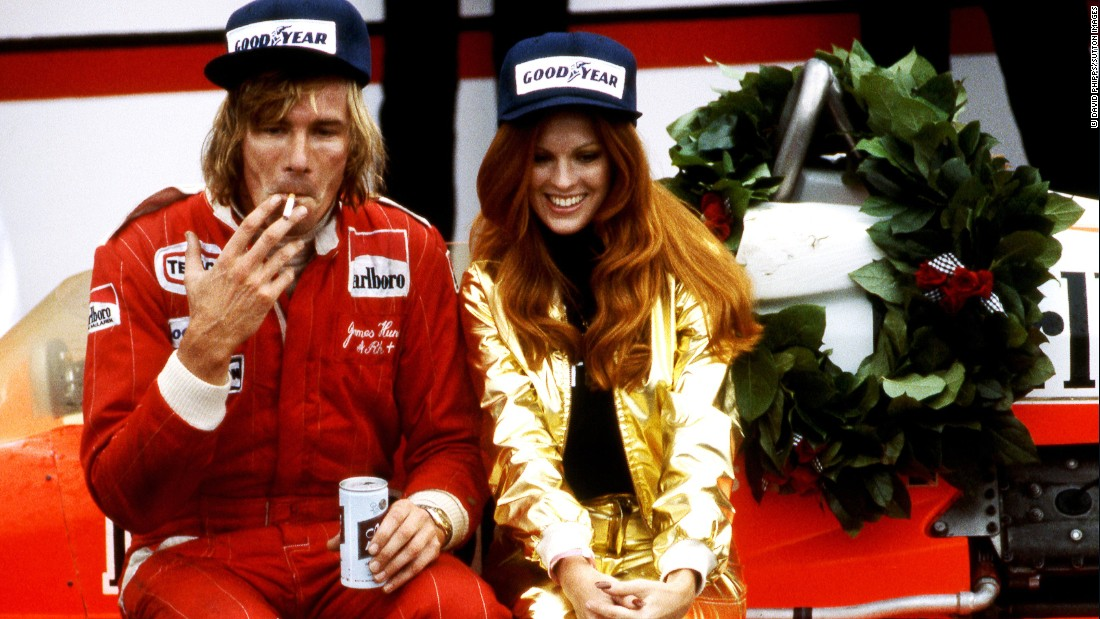 <strong>Photographer David Phipps share his images of James Hunt:</strong> Perched on his McLaren M26, James Hunt celebrates victory at the 1977 United States Grand Prix at Watkins Glen racetrack, New York. Hunt would often celebrate in playboy style -- with a cigarette, a beer, and a model by his side.