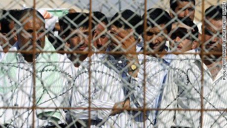 Detainees stand in the Abu Ghraib prison yard while waiting to be released on June 27, 2006 in Baghdad, Iraq.