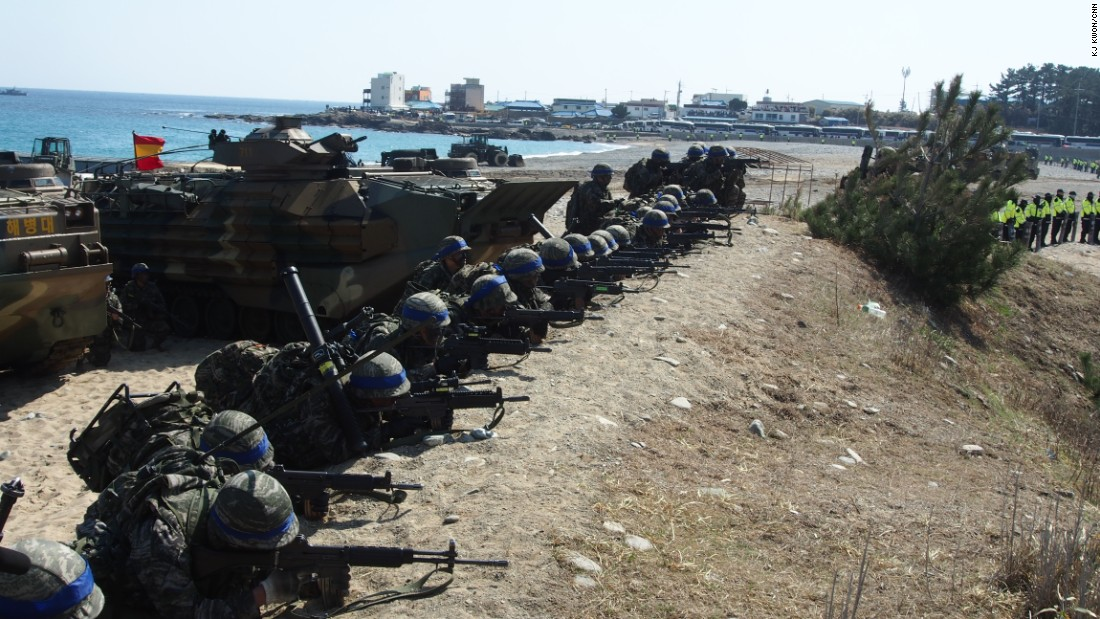 South Korean Marines points their weapons during the joint military exercises held on March 12.
