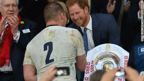 England captain Dylan Hartley received the trophy from Prince Harry.