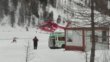 A rescue helicopter takes off in Valle Aurina in the Italian Alps to try to reach Monto Nevoso where at least six skiers have died in an avalanche Saturday, March 12, 2016.