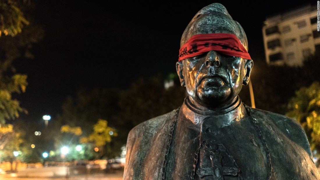 "The artist behind the blindfolds says they act as a way to shield the eyes of those who cannot do anything to change the country. All others, he says, have the ability to do something to change the ""shameful"" state the country is in."