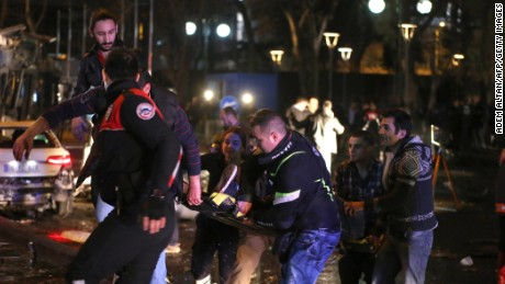 Rescuers carry a victim on a stretcher at the scene of a blast in Ankara on March 13, 2016.