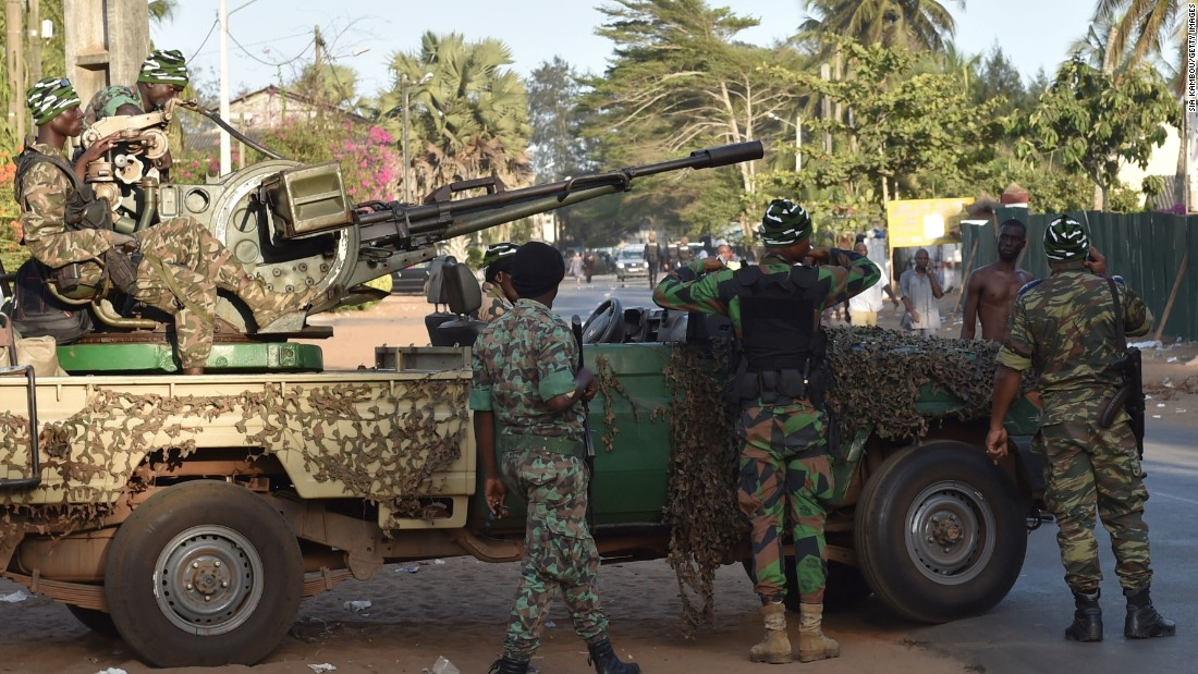Ivory Coast's armed forces take position outside one of the hotels.